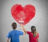 25208694-pareja-joven-de-dibujo-un-corazon-grande-en-una-pared